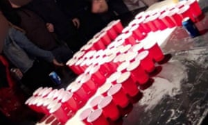 Students appeared to do the Nazi salute while standing around cups arranged in the shape of a swastika.