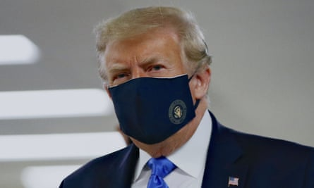 President Donald Trump wears a face mask.