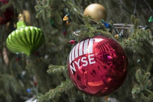 The New York Stock Exchange is seen reflected on an ornament hanging on a Christmas tree outside the exchange in New York