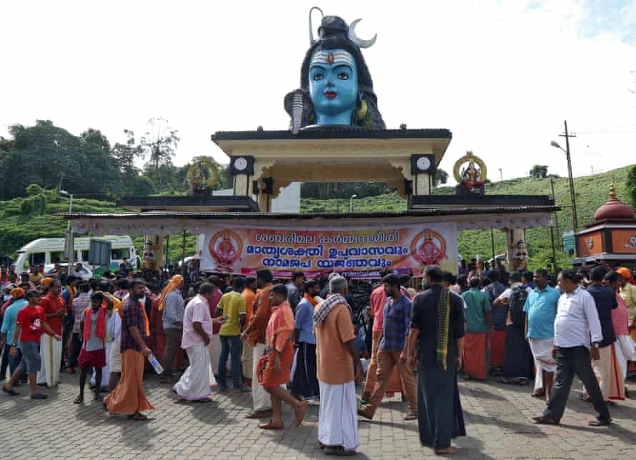 Hindu devotees gather in front of the temple to Lord Ayyappa