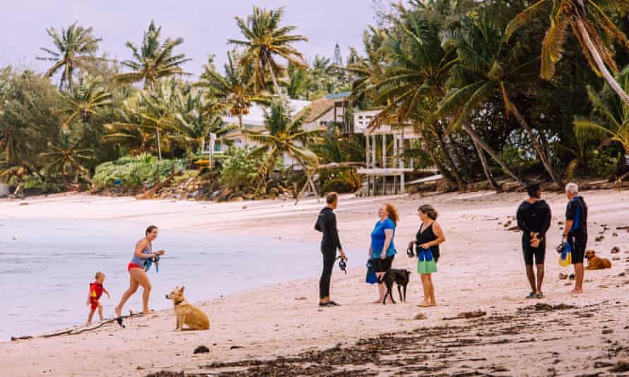 Tourists enjoy the pristine beaches of Rarotonga, Cook Islands.