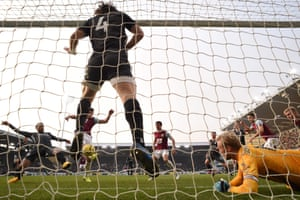 Burnley's striker Chris Wood scores the equalising goal against Leicester City. Ashley Westwood's effort in the 79th minute gave Burnley a 2-1 win and ended a run of four straight defeats.