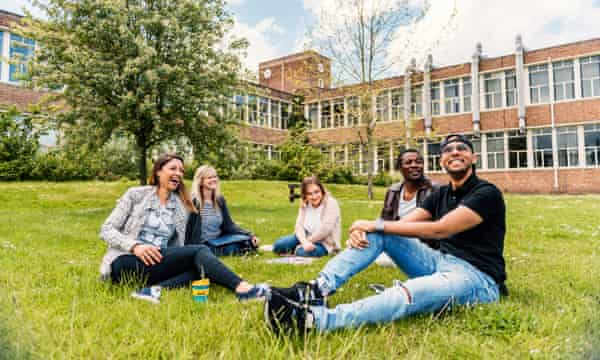 Students on a lawn at Glyndwr University.
