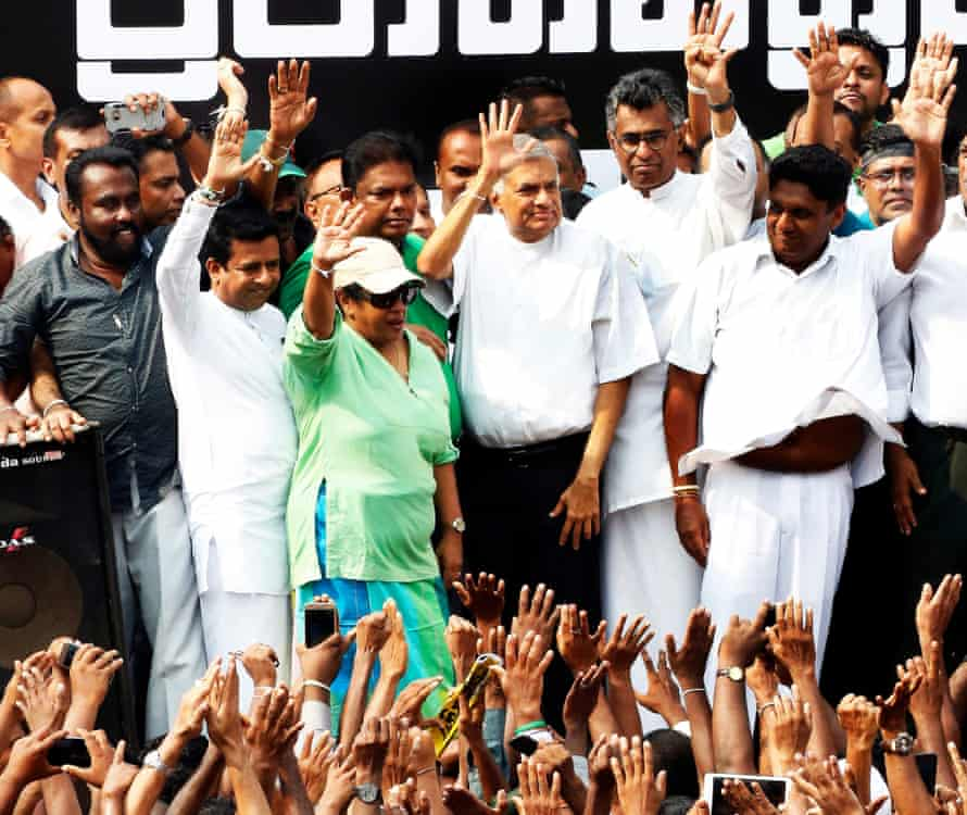 Former Sri Lankan leader Ranil Wickremesinghe acknowledges supporters at a rally in Colombo on Tuesday.