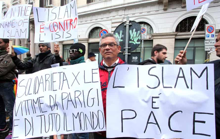 Members of the Roman Muslim community hold a banner reading in Italian 'Solidarity with French people, no to terrorism in the name of god' during a demonstration against violence organized by the Italian Union of the Islamic Communities.