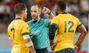 Australia's flanker Michael Hooper (left) and centre Samu Kerevi listen to French referee Romain Poite after a high tackle.