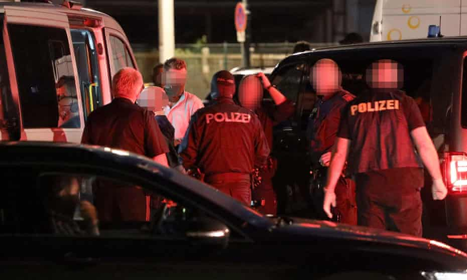 Police detain a man after a raid in Linz in which they arrested a suspect in the killing of a Chechen asylum seeker.