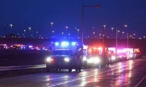 The procession of emergency vehicles makes its way out of Denver International Airport.