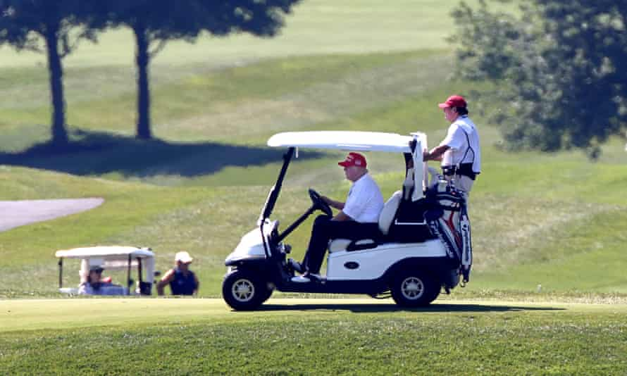 Trump plays golf in Sterling, Virginia, in July.