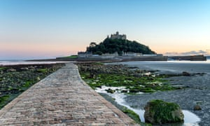 The sea causeway at low tide leading to St Michael's Mount a small isle off Marazion near Penzance in Cornwall
