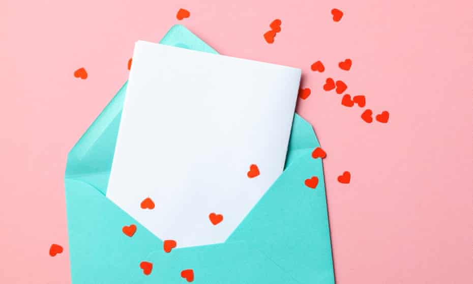 Green envelope with red hearts and blank letter on pink background.