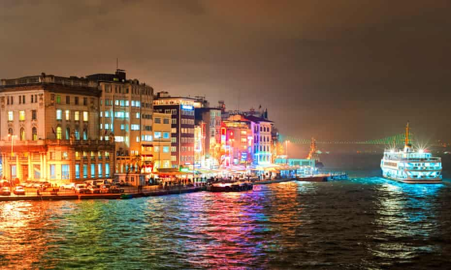 Night view of a ferry and the Galata quarter of Istanbul, Turkey.