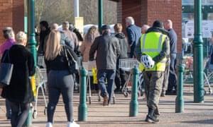 Shoppers queue outside Morrisons