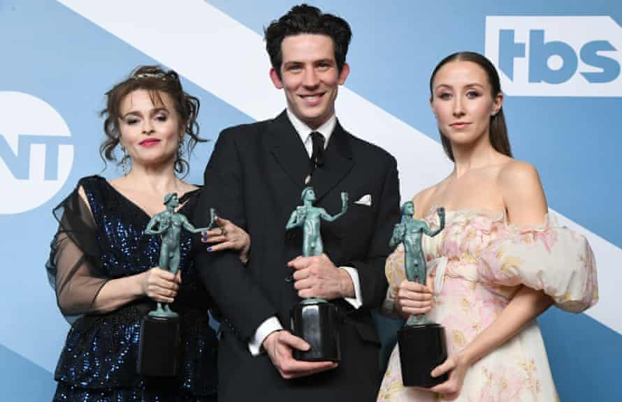 """Helena Bonham Carter, Josh O'Connor and Erin Doherty pose with the trophy for Outstanding Performance by an Ensemble in a Drama Series for """"The Crown"""" in the press room during the 26th Annual Screen Actors Guild Awards at The Shrine Auditorium on January 19, 2020 in Los Angeles, California"""