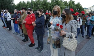 Participants in the Memory Watch event bring flowers to the Tomb of the Unknown Soldiers in Moscow's Alexander Garden to mark the 79th anniversary of the German invasion of the Soviet Union in World War II.