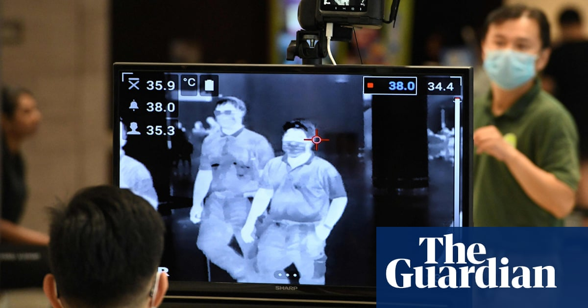 Drones, fever goggles, arrests: millions in Asia face 'extreme' Covid surveillance