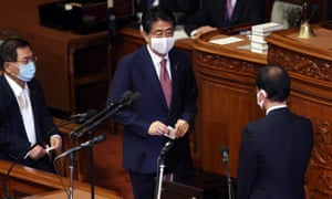 Former Japanese prime minister Shinzo Abe casts a vote at the election for his successor.
