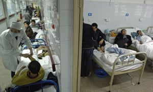 Patients on beds overflowing into the corridors of a hospital in central China's Anhui province
