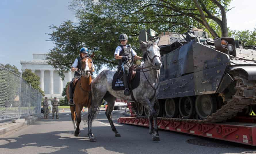 Mounted US park police pass by an armored Bradley fighting vehicle near the Lincoln Memorial in Washington DC, on 3 July.