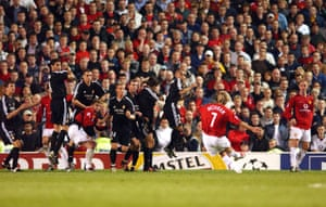 David Beckham hits the free-kick to score United's third goal.