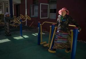 An elderly Tibetan woman exercises at the Caigongtang Nursing Home