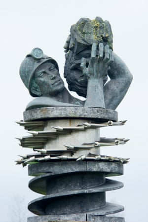 Sculpture of a miner's head and arms.