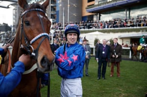 'You finish second and you're getting more of a reception than the winner? He's unbelievable – the most loved horse in jump racing.' Paddy Brennan takes his saddle off Cue Card after they finished second in the Betfair Chase at Ascot