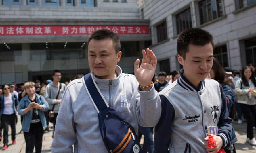 Sun Wenlin and his partner Hu Mingliang leave court.