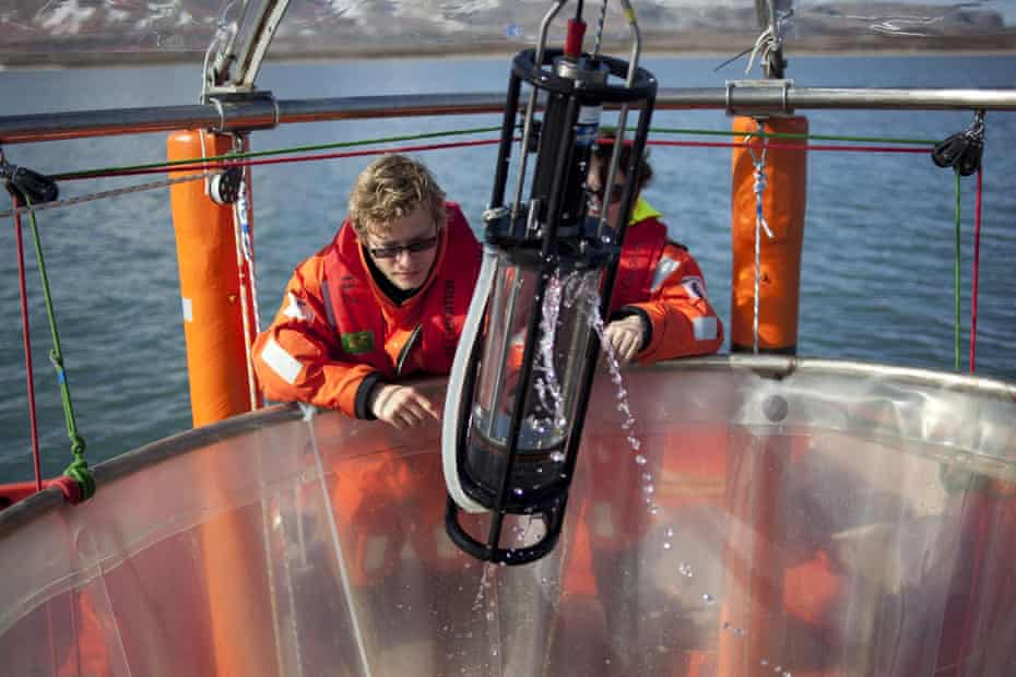 Scientists haul in samples of seawater in Svalbard, Norway. Greenpeace is working with the German marine research institute to investigate ocean acidification