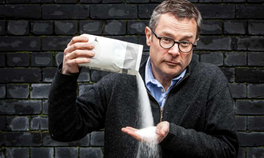 Hugh Fearnley-Whittingstall pouring a bag of sugar into his hand
