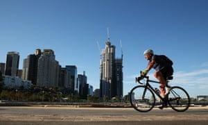 Cyclist rides through Sydney.