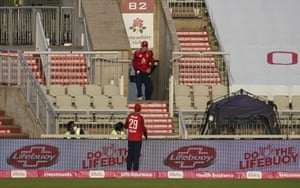 England's Tom Banton, top, retrieves the ball from stands after a six from Pakistan's Mohammad Hafeez.