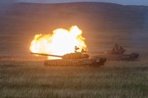 A tank fires a weapon