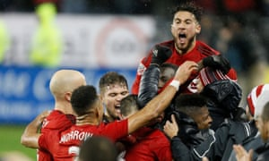 Toronto FC midfielder Jonathan Osorio celebrates with team-mates after his team's Eastern Conference final victory over Montreal Impact.