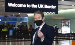 Keir Starmer at the UK Border Control area during a visit to Heathrow airport.