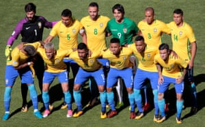 Bolivia's Marcelo Martins (in green) lines up with the Brazil team.