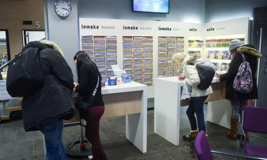 Clients in a social insurance institution office in Helsinki, Finland