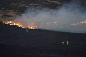 Firefighters cross the moor at first light