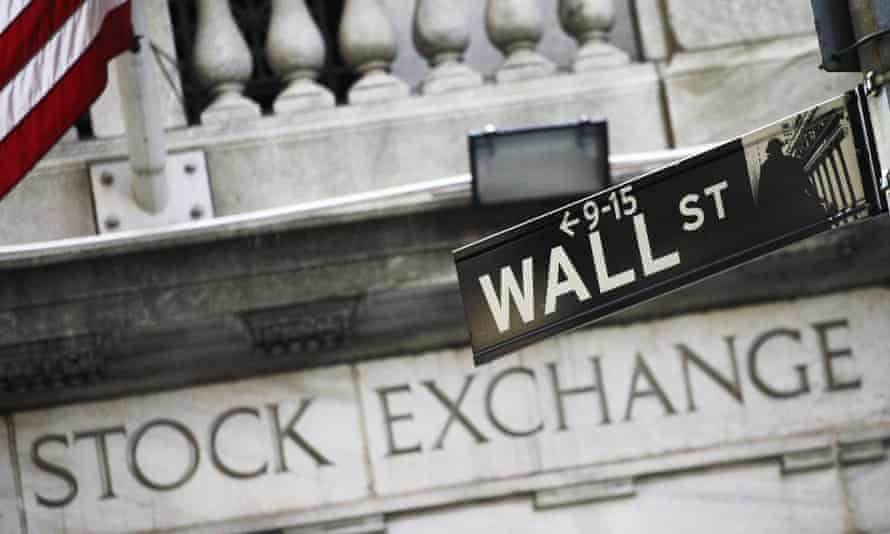 the Wall Street road sign and NYC stock exchange sign