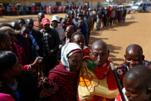 Voters wait in line to cast their votes at a polling station in Iloodokilani, Kajiado county