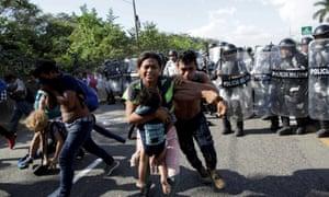 Mexico's national guardsmen confront a procession of Central American migrants near Frontera Hidalgo, Chiapas.