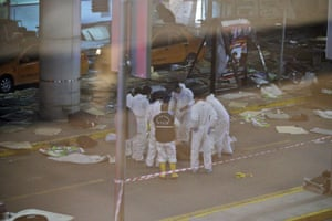 Turkish forensic police officers work at the scene of a blast outside Istanbul Ataturk airport.