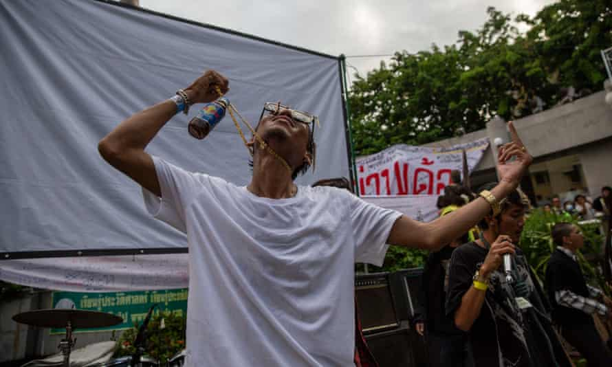 A protester holds up a bottle of Red Bull during a pro-democracy demonstration in Bangkok in August.