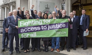 Unison members hold a banner reading 'Fighting for access to justice for all'