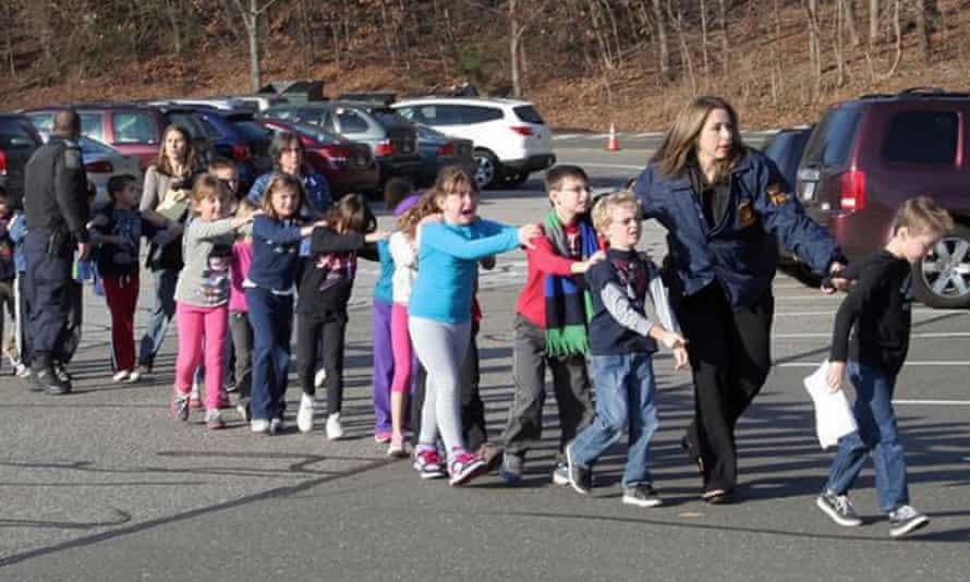 Police lead children from the Sandy Hook school in December 2012.
