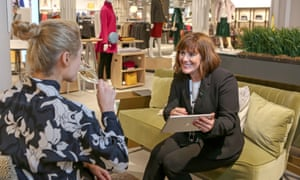 A woman trying John Lewis's private shopping experience