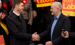 Jim McMahon shakes hands with Jeremy Corbyn after winning the Oldham East byelection.