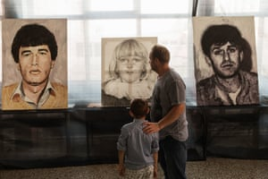 ZB and his son at the exhibition Guilty of Nothing by painter Mensur Bešlagić in Kozarac, a town near Prijedor. They stand in front of an image of the man's cousin, who was killed in 1992. She was six years old. The paintings were inspired by a similarly titled book Guilty for Nothing, which has 3,176 images of civilians killed during the war, between 1992 to 1995