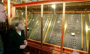 The German chancellor, Angela Merkel, stands beside the museum's director, Dirk Syndram, during a visit in 2006