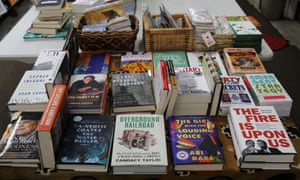 A table at Marcus Books in Oakland, California, features books written by black authors.